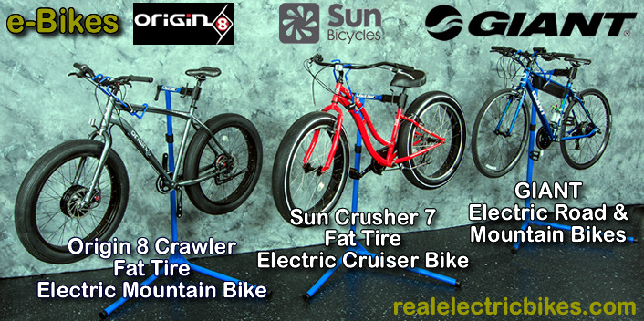 Powerful, lightweight electric assist bicycles with 36 Volt and 48 Volt geared/ direct drive motors and 9, 10, 12, 15 and 16 Amp hour lithium ion battery packs - including the Origin 8 Crawler fat tire e-mountain bike, Sun Crusher 7 fat tire e-cruiser bikes and Giant electric pedal assist hybrid/ road/ commuter and e-mountain bikes